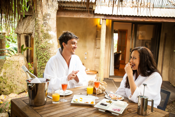 couple-enjoying-hearty-breakfast-outside