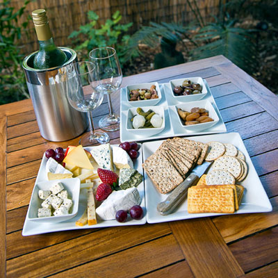 cheese platter with a variety of hard and soft cheeses
