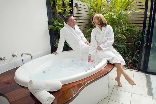 Couple enjoying the spa bath