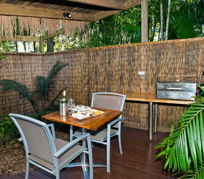 Dining in outdoor courtyard garden with BBQ