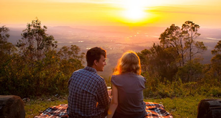 Couple enjoying the sunset from Tamborine Mountain