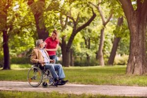 Wheelchair Assisted Person Enjoying Day Out