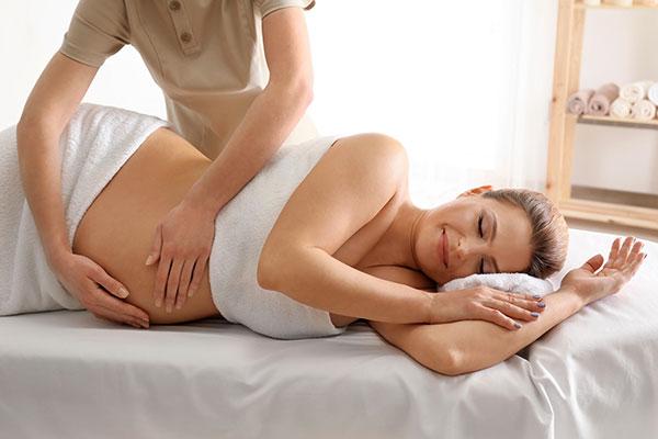 Pregnant woman enjoying relaxing massage