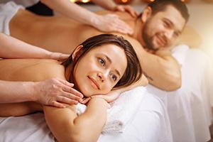 Couple enjoying a pampering massage with Ripple Massage