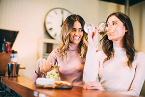 Two women wine tasting at Witches Falls Winery