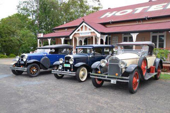 3 Historic Cars parked outside Royal Hotel