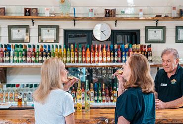 Two women enjoying a tasting at the Tamborine Mountain Distillery