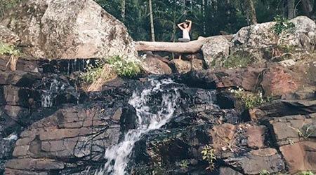 Girls watching Cameron Falls Flowing