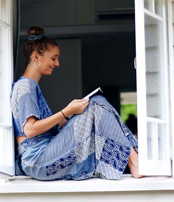 Girl Reading a book in the Window