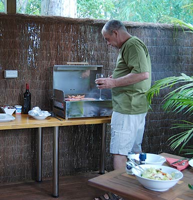Guest cooking a BBQ dinner outside