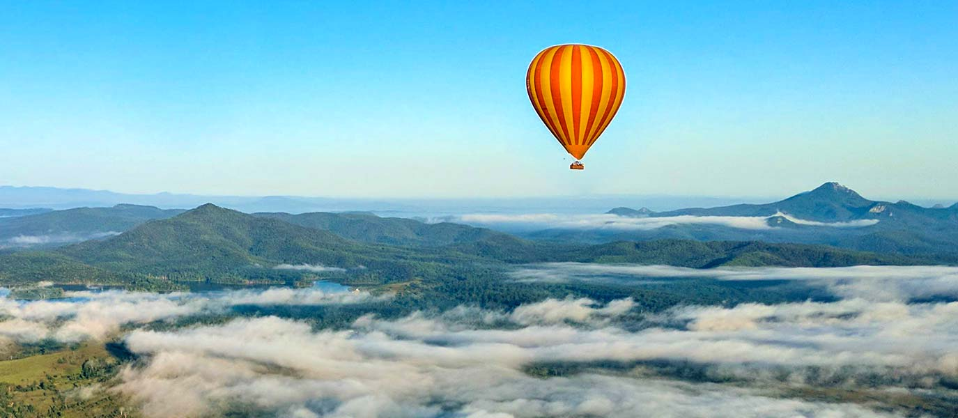 Hot Air Balloon flying above the mist over Scenic Rim
